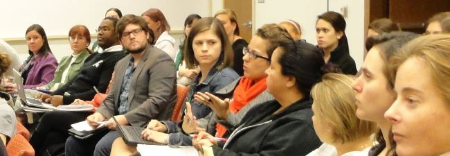 Higher education doctoral student Rachel McDonald asking Dr. Kanter a question