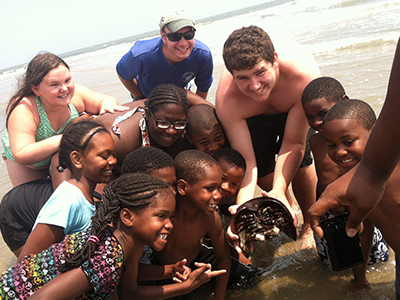Summer internships allow scholars to experience science education in the field